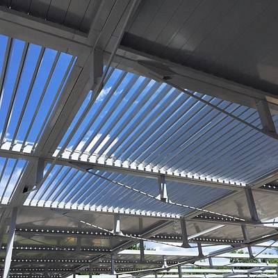 PROJECT AUTOPARK in Switzerland – ARAUU – Bioclimatic pergola Agava XL. The biggest Pergola in Europe – 1.300 m2, 2.350 blades, 19 tons, 100 LED lights and a fully automated adjustment based on position of the sun, rain and snow. Optimization, calculation, conception, production, supply, installation.
